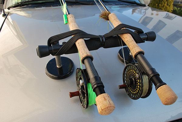A suction cup mount is a good way to carry three fly-fishing setups when cruising the beach. Be sure to position the flies so that they face forward into the wind.