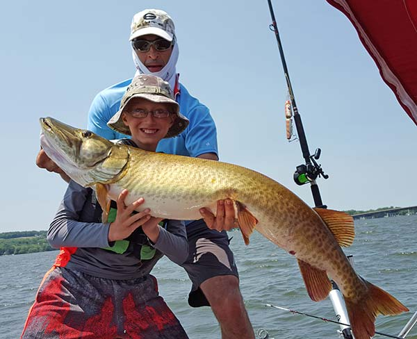 Mike and Mason Marzo with a huge 49.5-inch muskie caught while trolling Lake Chautauqua.