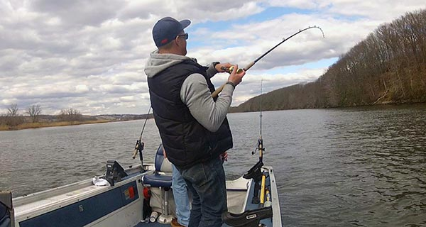 Trolling umbrella rigs and crankbaits can be a productive way to locate schools of holdover stripers,