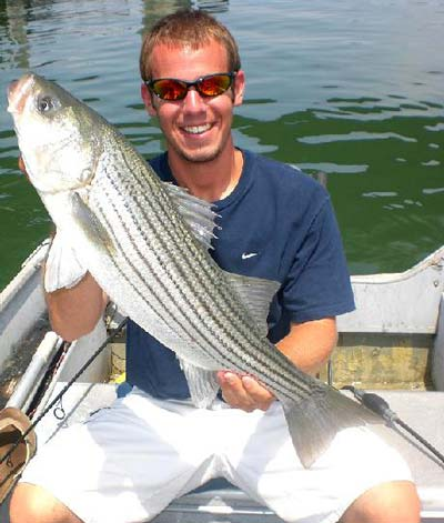 A back-bay striper taken on clam bellies in the middle of the day