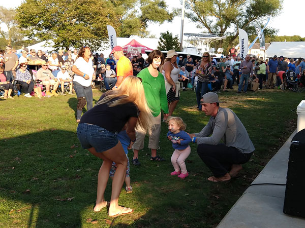 family dancing at StriperFest 2018