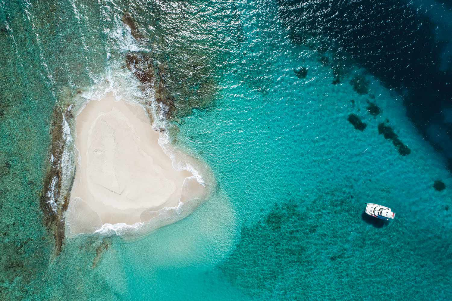 The author's chartered Aquila 44 approaches Sandy Spit, a sandbar just off Jost Van Dyke.