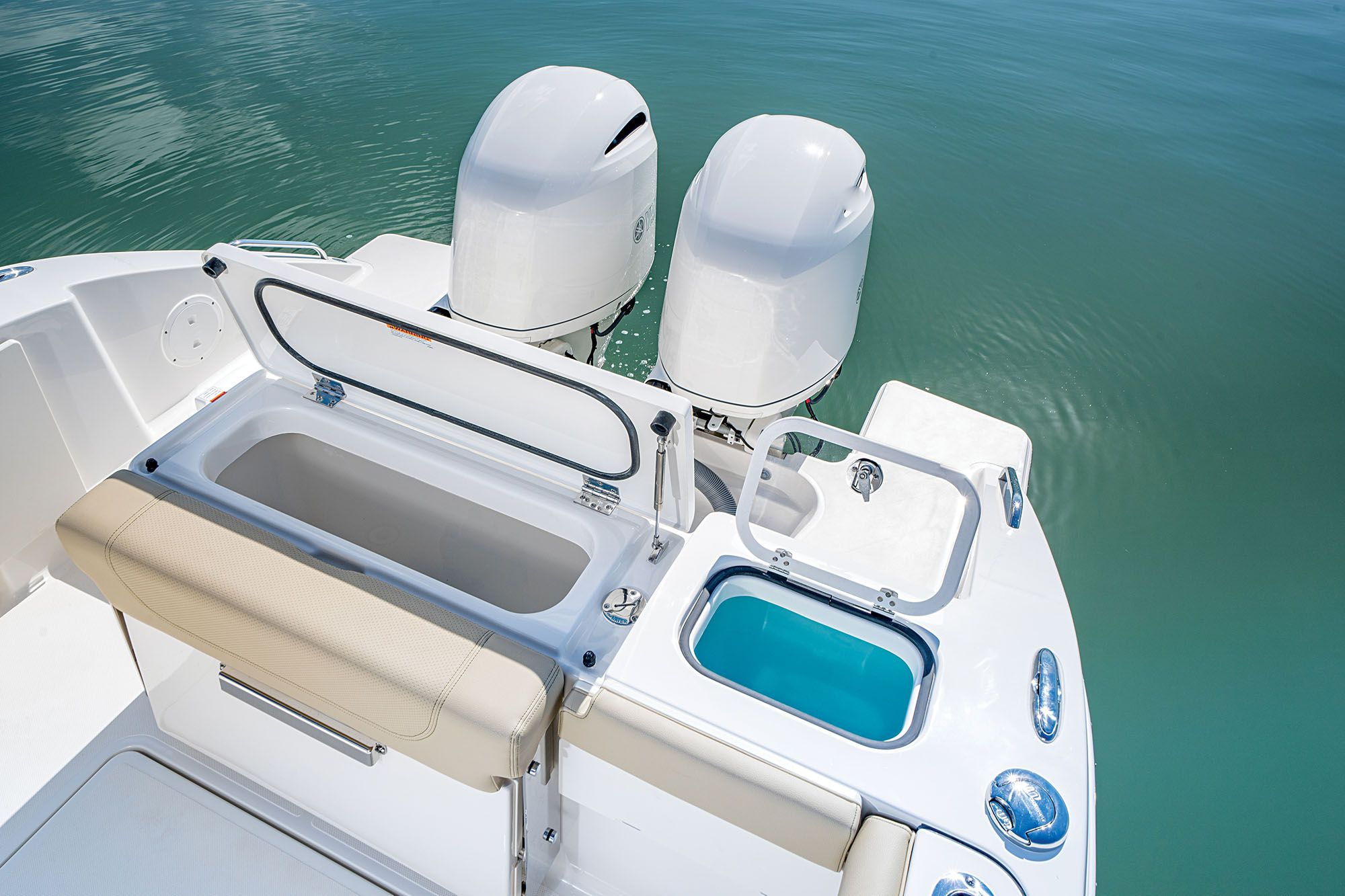 The transom houses a 20-gallon livewell with clear lid, and a 31-gallon insulated fish box next to it.