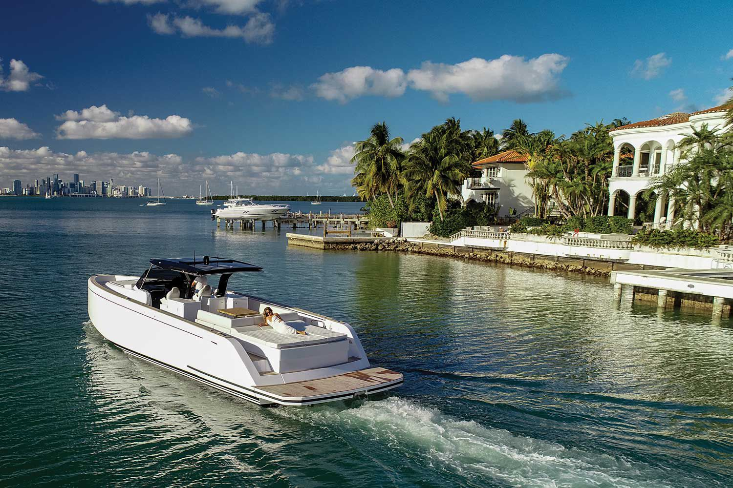 The transom sun pad measures 7 feet, 6 inches wide. High gunwales and 30-inch-wide side decks are designed for safe transit around the yacht.
