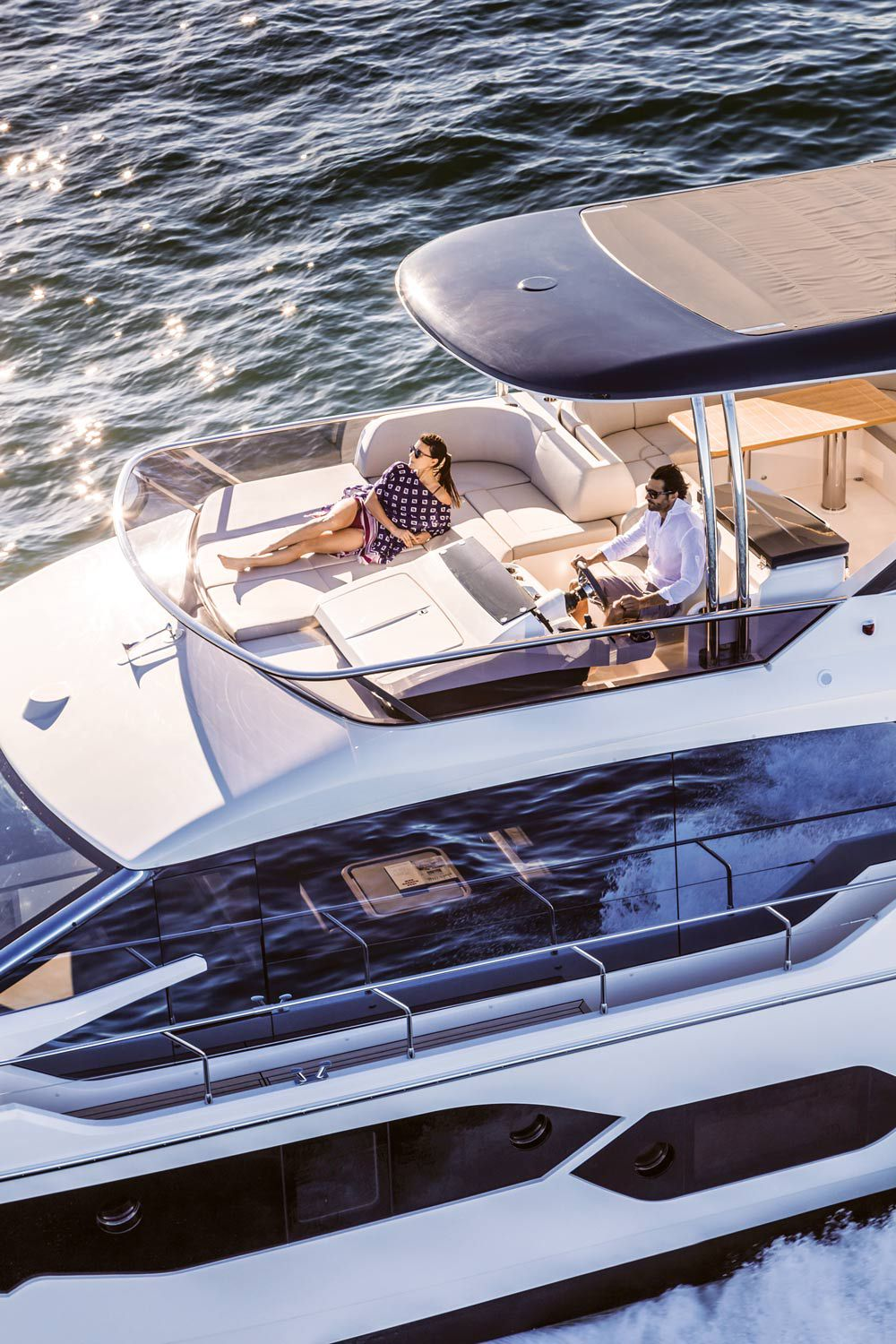 The Absolute 58 Fly's optional hardtop offers shade when desired while allowing for a good tan forward.