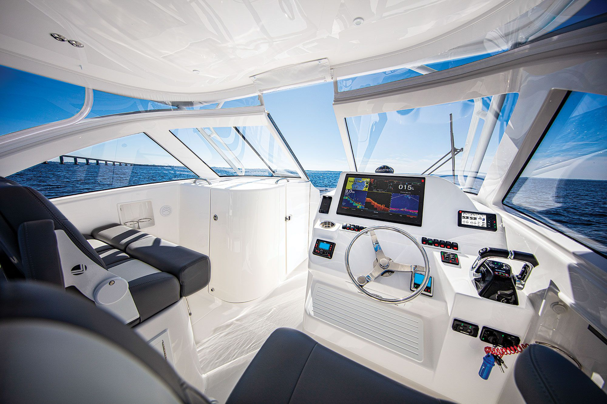 The helm, with ample room for electronics, resides on the starboard console.