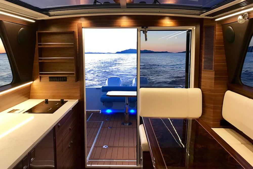 Note the galley aft with two-burner cooktop and fridge/freezer.
