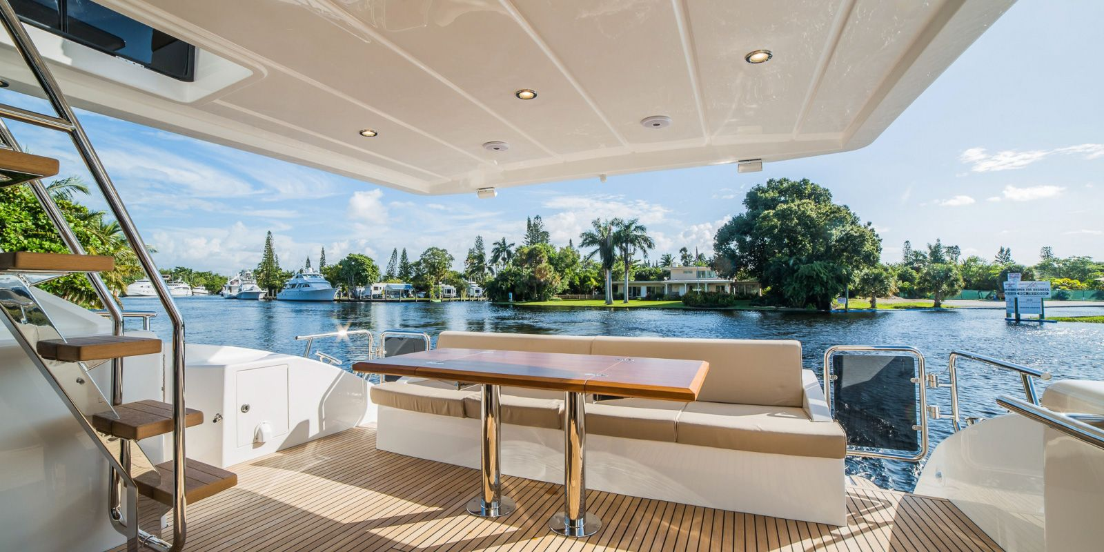 Al fresco dining is partially shaded by the extended flybridge overhang.