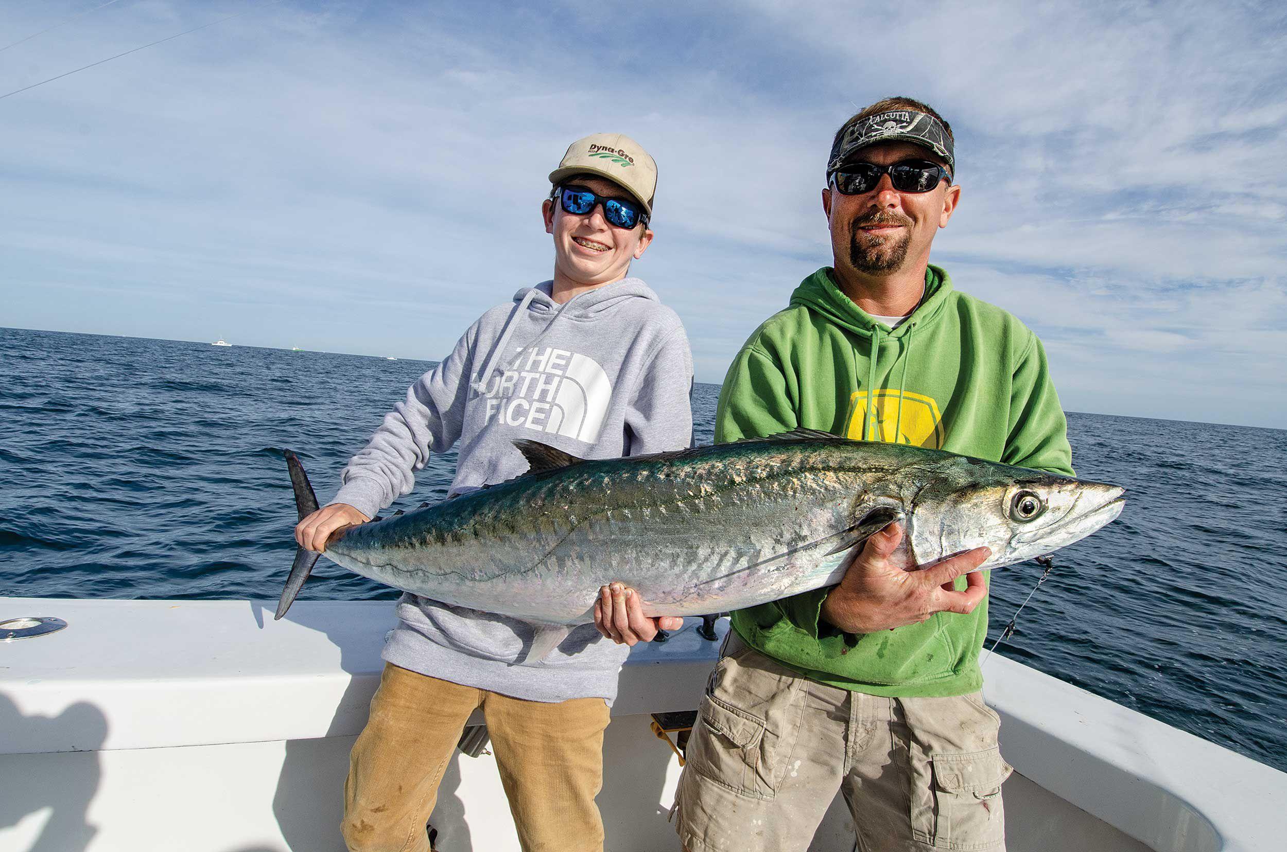In addition to good reflexes and fishing skills, boating a big king often requires coordination between the angler and crew.