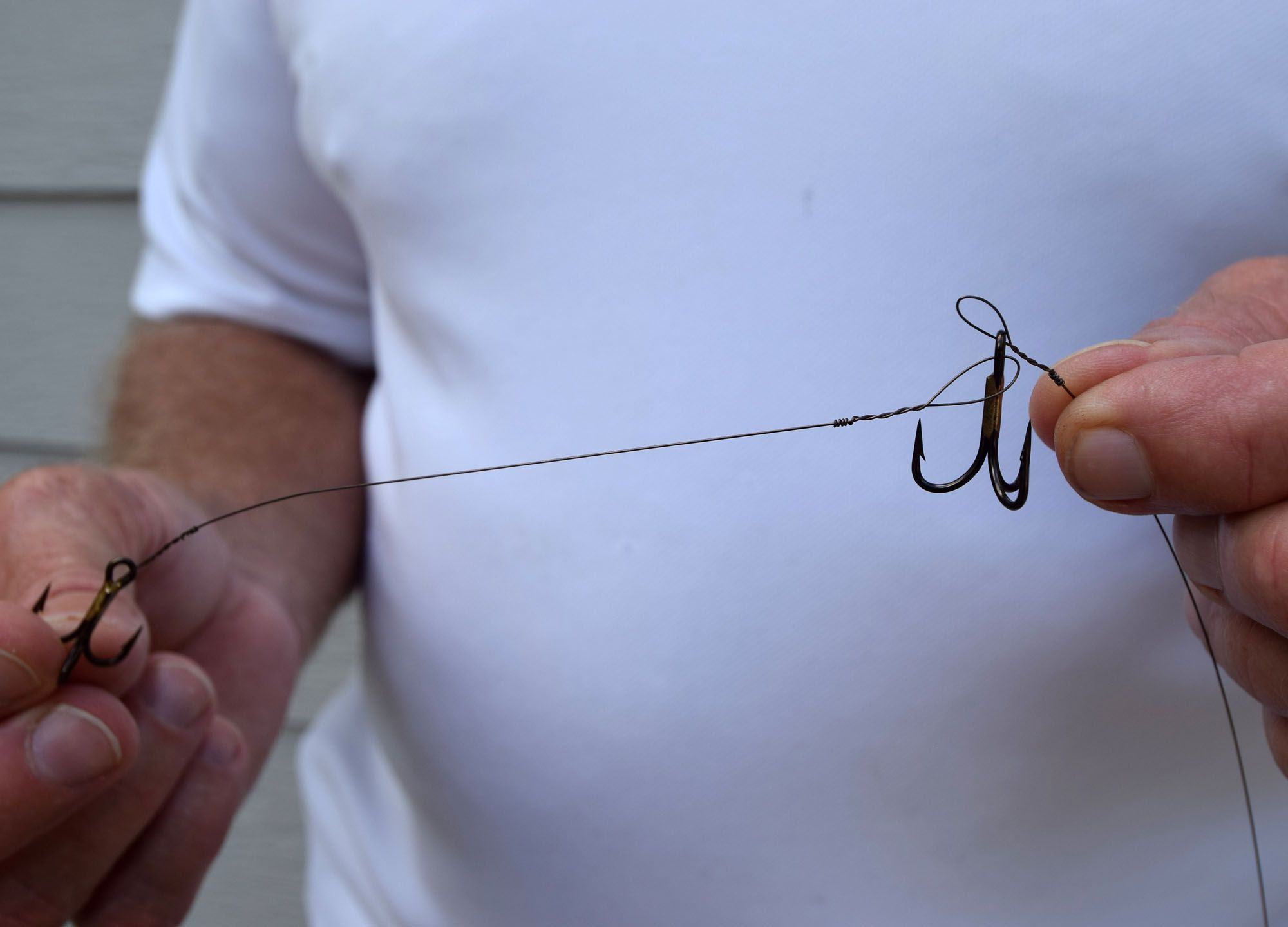 Two treble hooks twisted onto each end of a wire section.