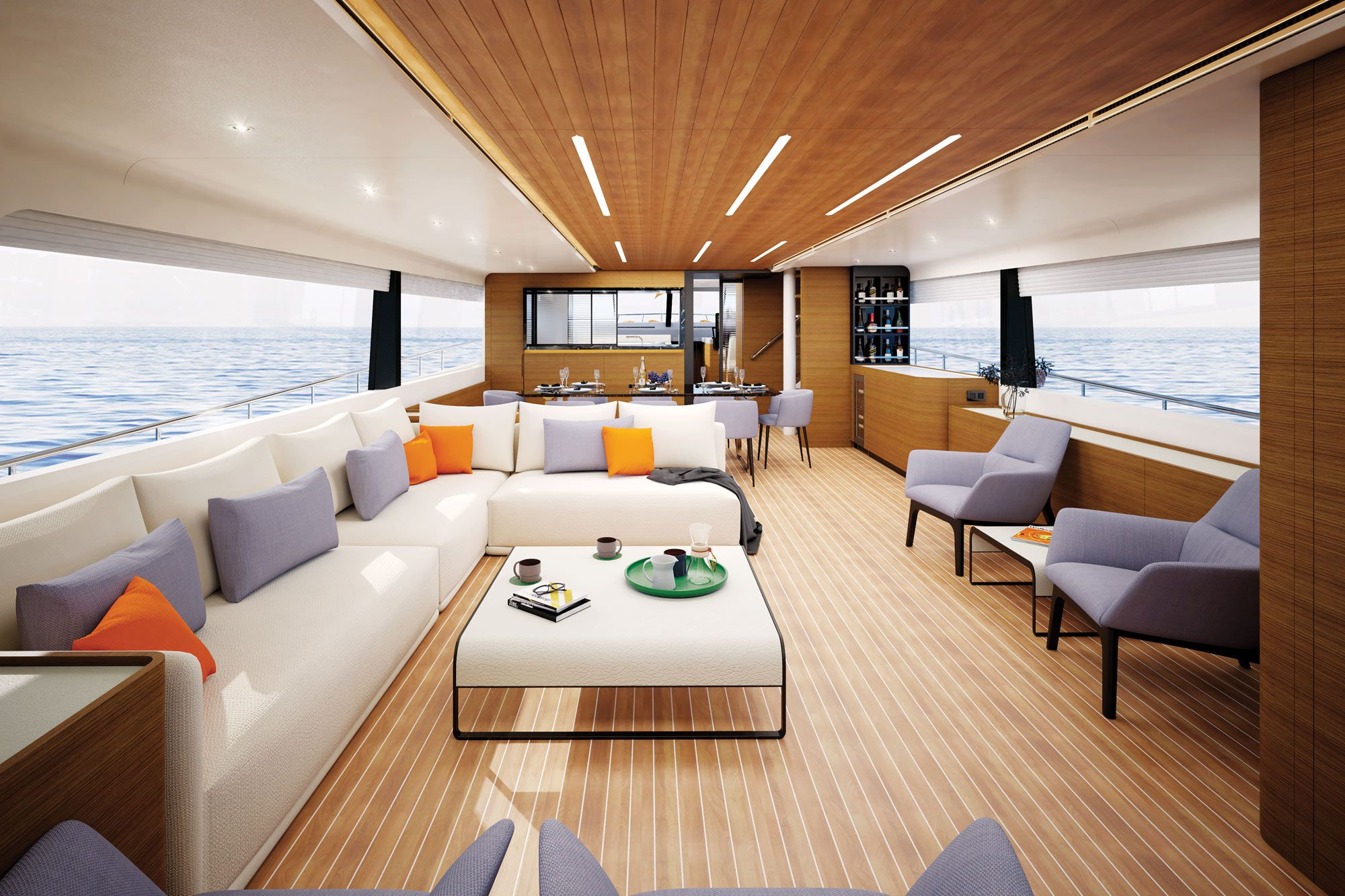 The main deck has a constant connection to the sea with nearly 360 degrees of glass. Ambient light adds to the sense of interior volume. The salon has an L shaped settee to port with two loose chairs across, and there is formal dining for six guests forward of the sitting area.