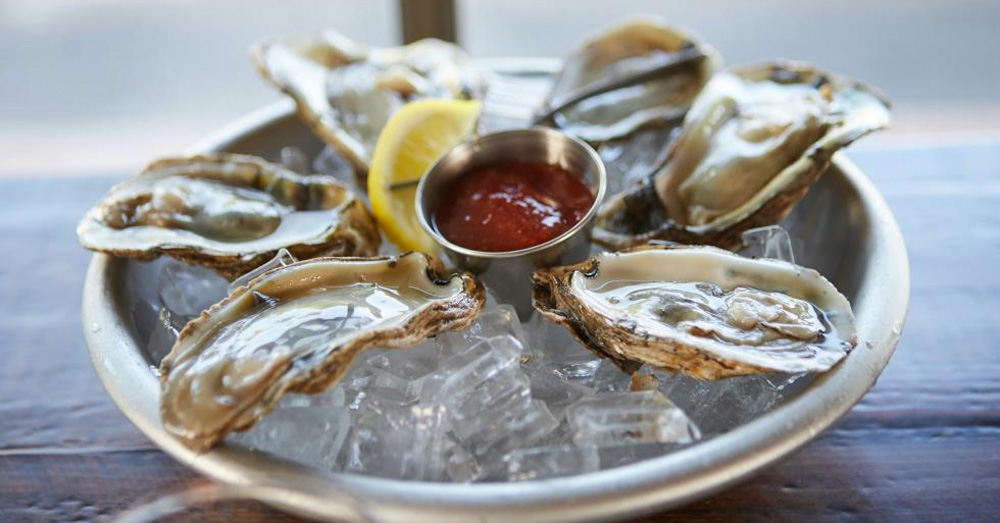 raw oysters with cocktail sauce