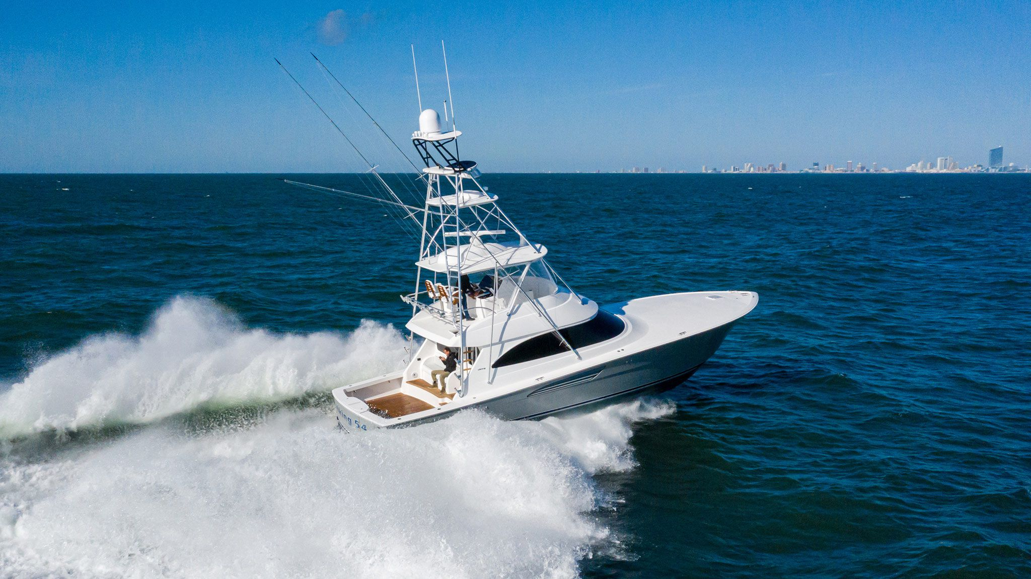 The Viking 54 Convertible is a three-stateroom, two-head, open-bridge sportfishing yacht with a 154-square-foot cockpit. With twin 1,550 hp MAN diesels, the builder reports a mid-30-knot cruise speed and 40-knot-plus top-end speed.