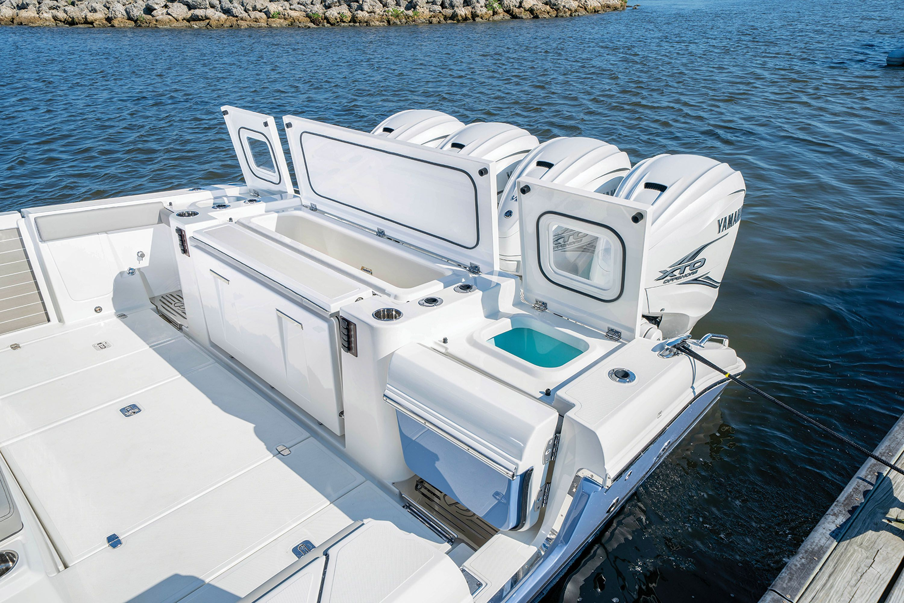 Twin 36-gallon livewells on the transom bookend a 68-gallon refrigerated fish box.