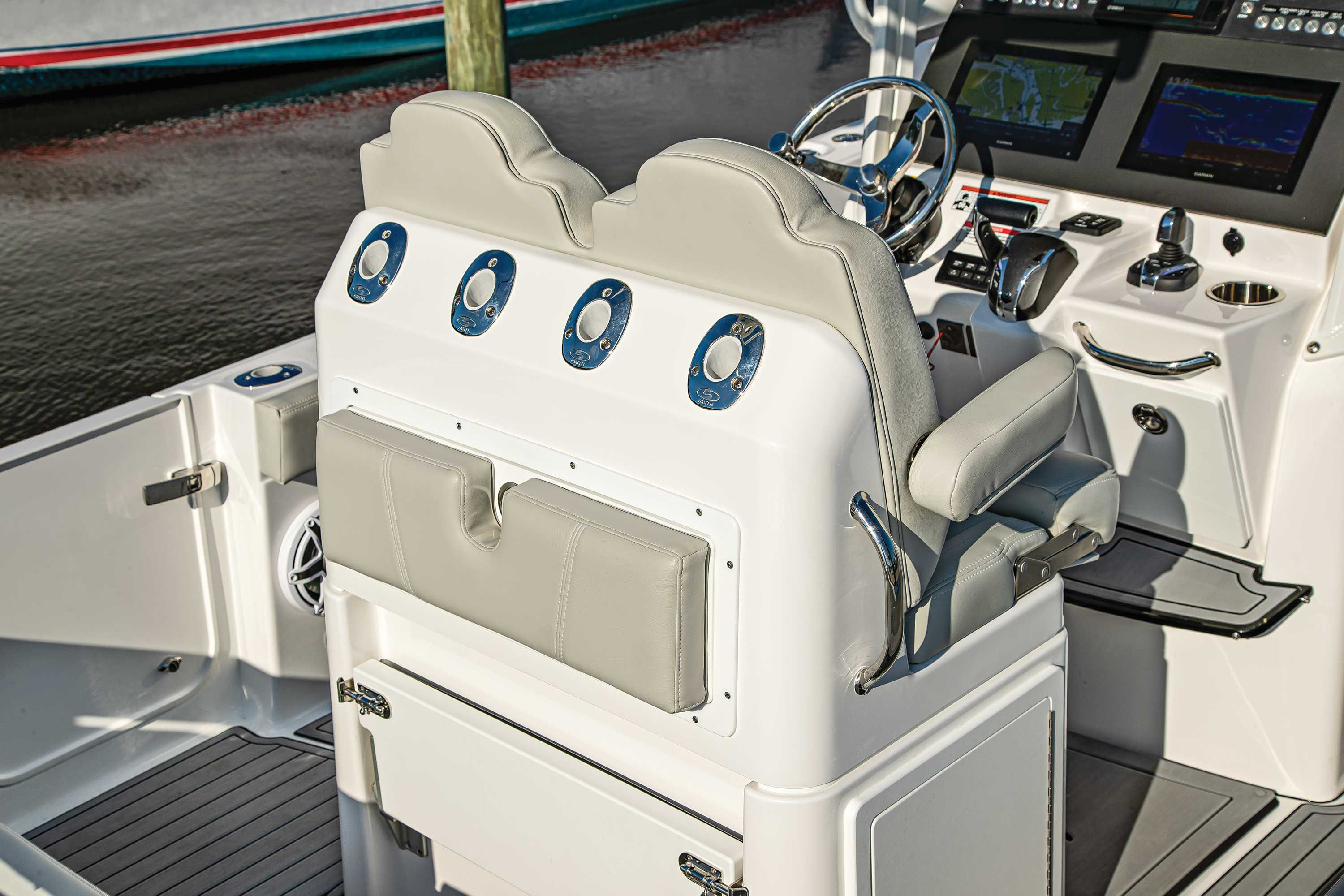 The helm seating pod includes rod-and-tackle storage, plus a fold-down rigging table.