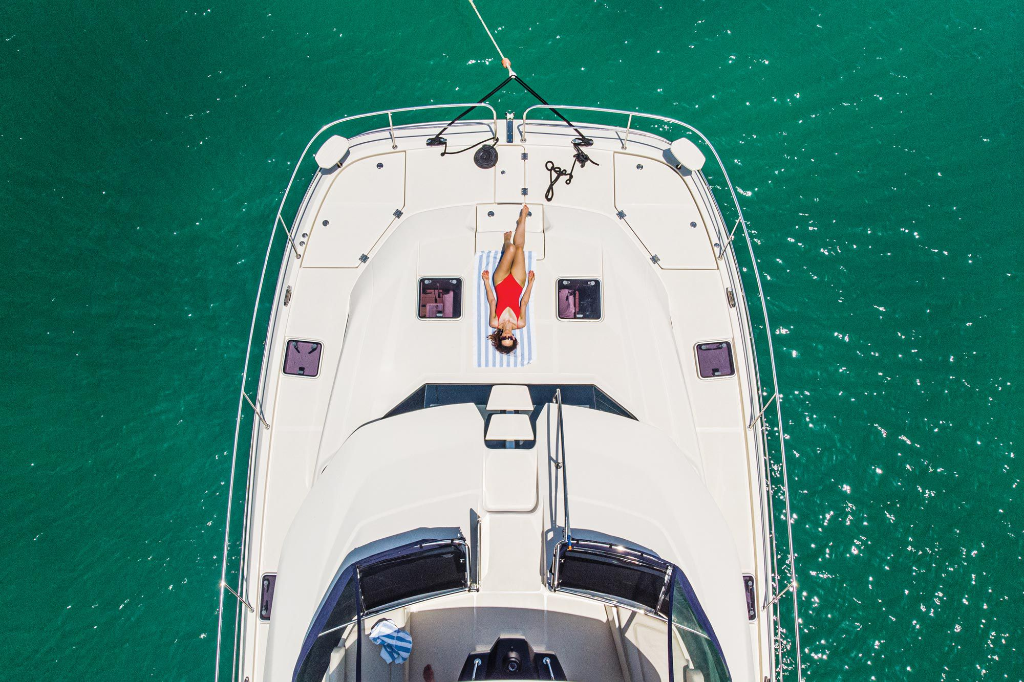 Booking a catamaran charter means it doesn't matter what's open or closed ashore. Relaxation awaits on the foredeck.