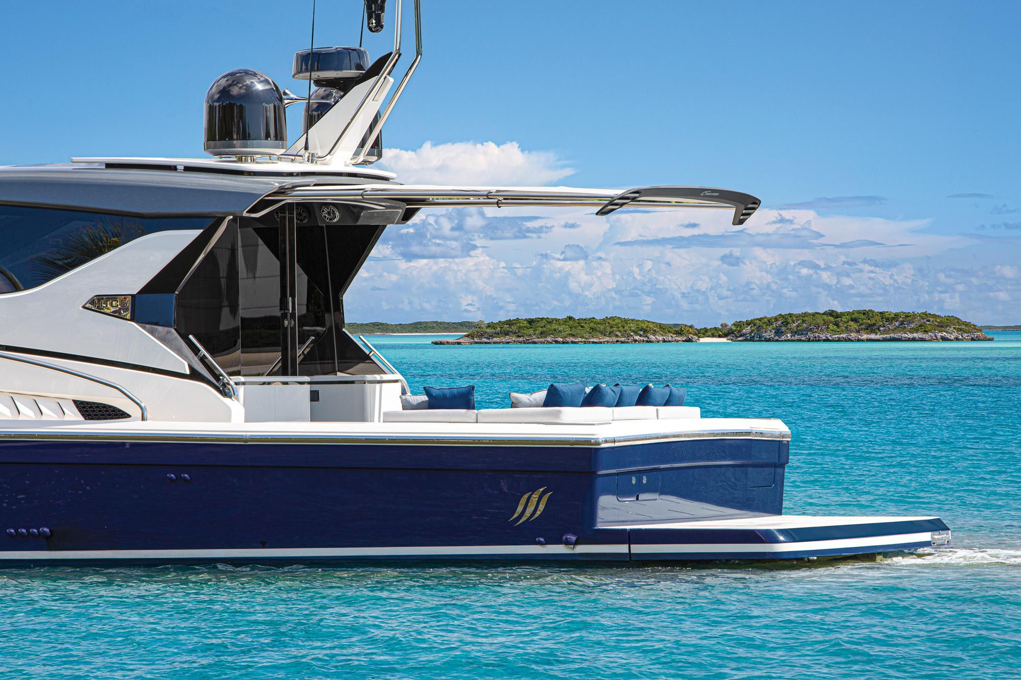 When not in use, the HTC5's retractable sunshade tucks away, helping maintain the yacht's sleek profile.