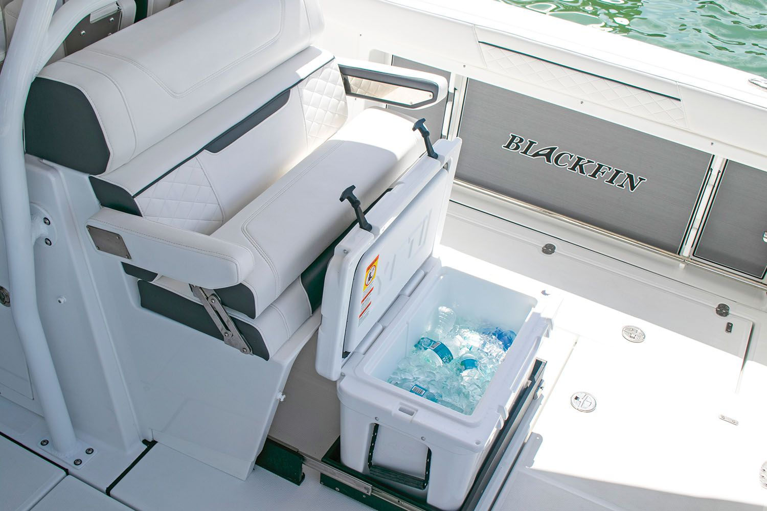 A slide-out cooler complements mezzanine seating, which can be swapped for a tackle-rigging center.