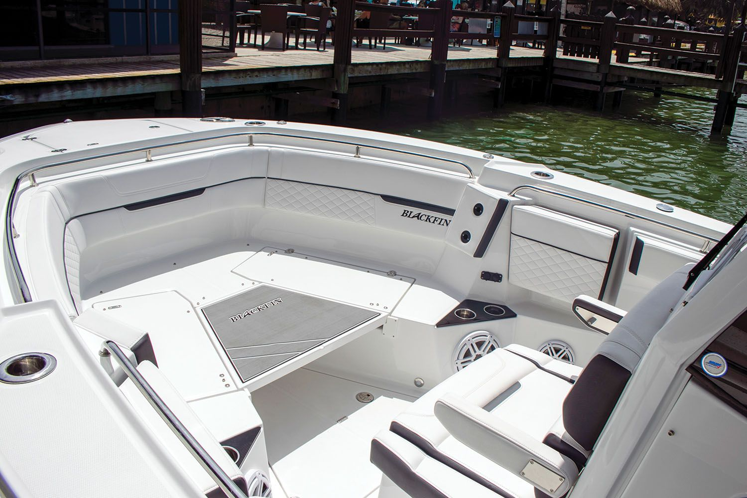 Bow U-shaped seating includes a filler that bridges the gap to form a raised casting deck.