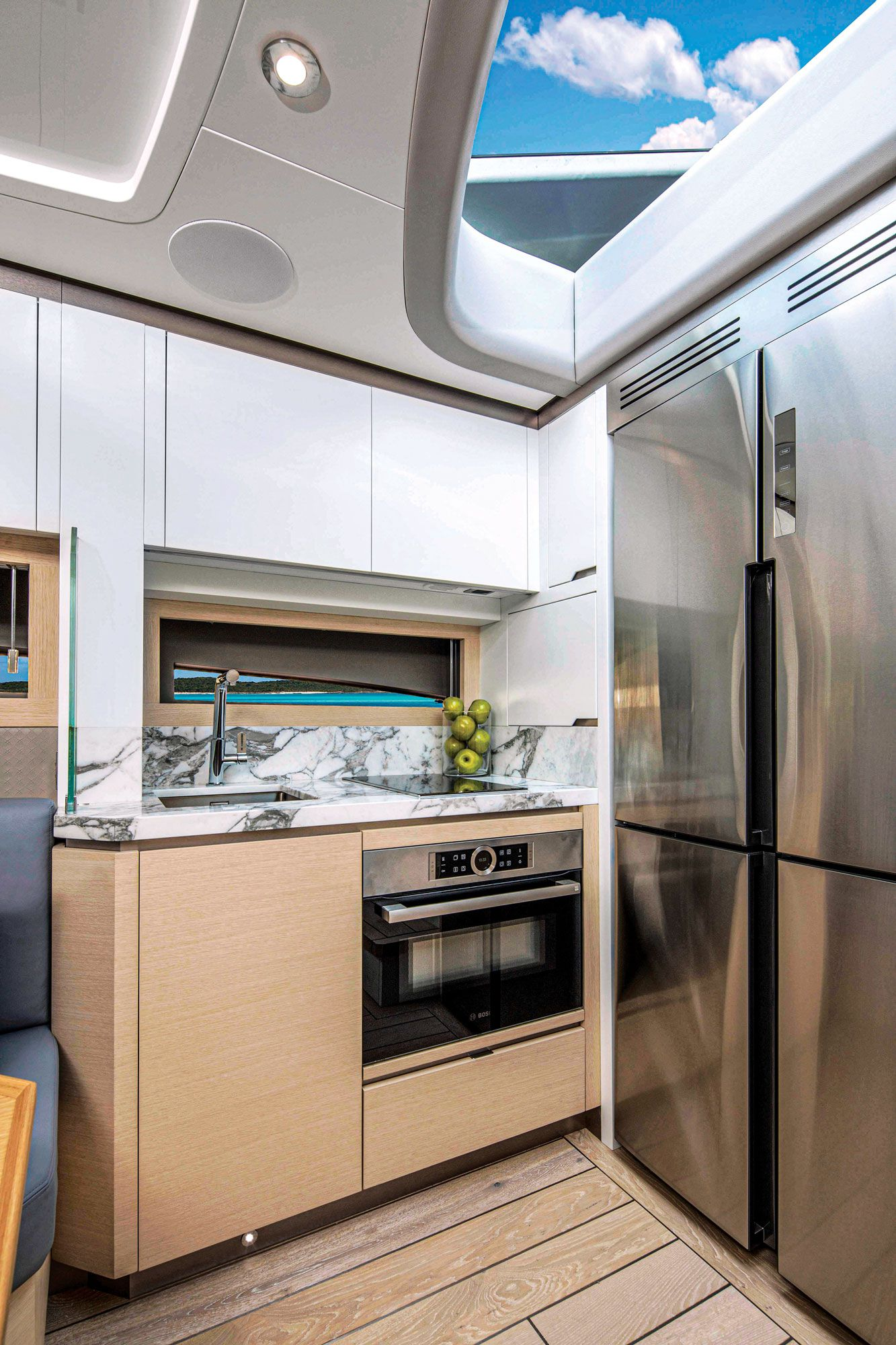 A windshield above the galley keeps the space bright and creates an atrium-type feeling.