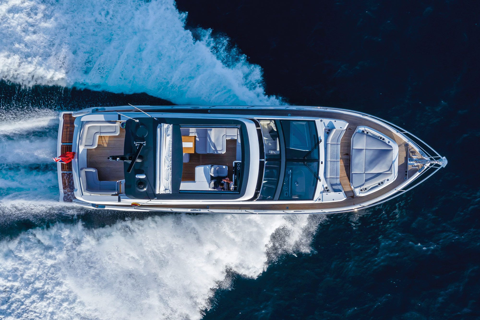 This bird's-eye view illustrates the three well-appointed alfresco zones found on the Pearl 62.