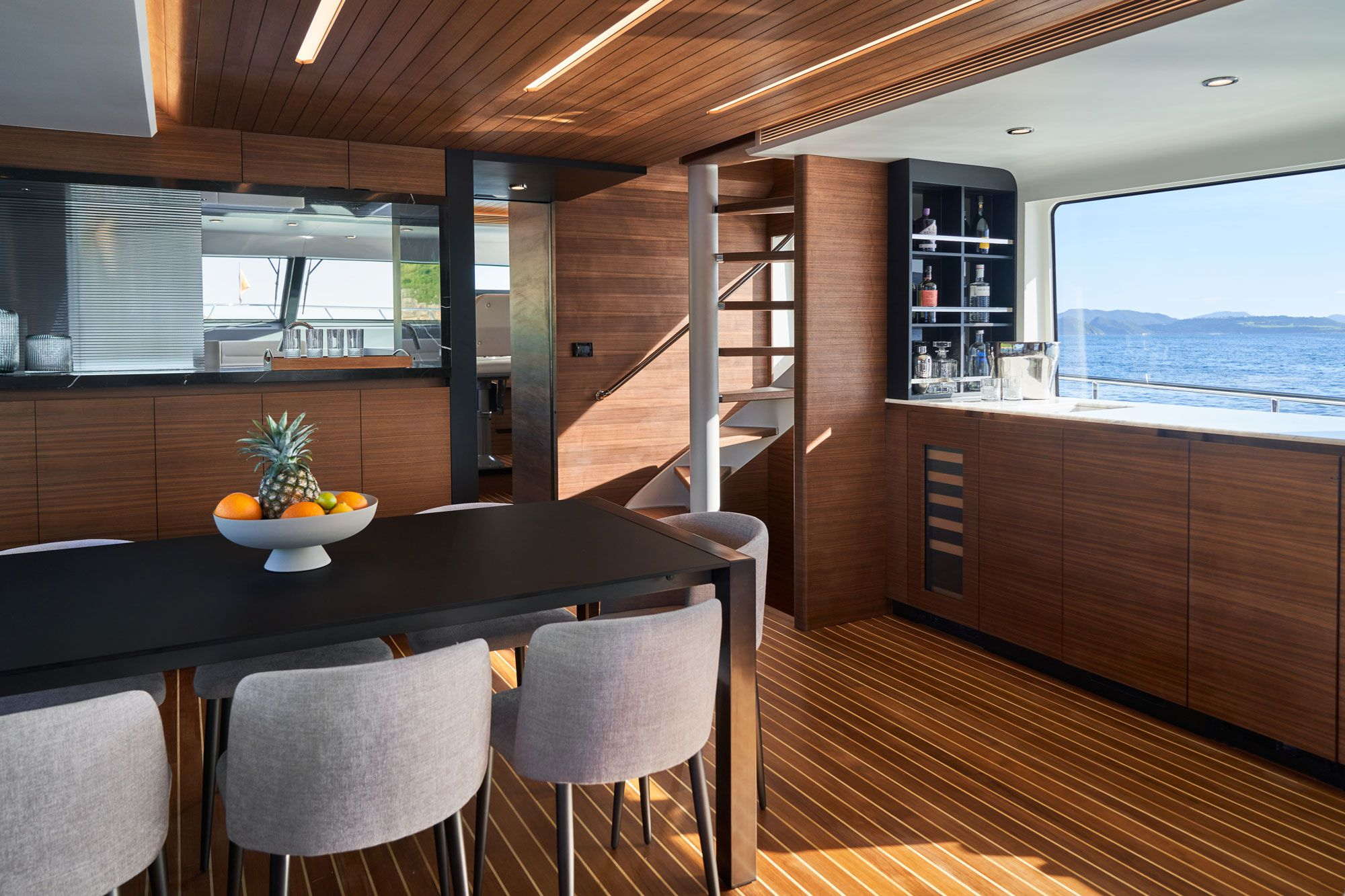 """The salon dining table expands to accommodate 10 guests. Note the """"floating"""" stairway."""