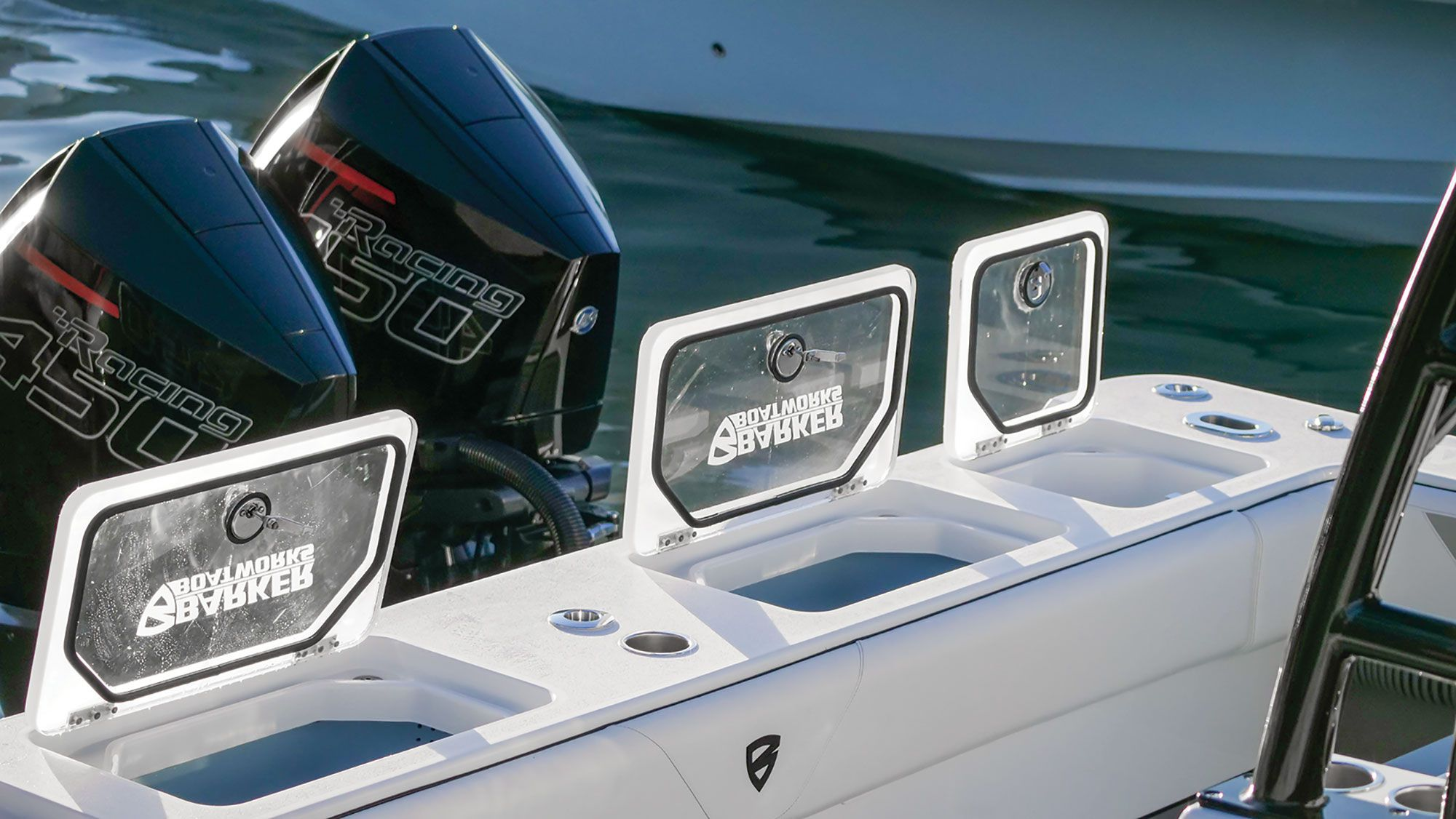 Two coolers and two of the four 55-gallon baitwells sit on the transom.
